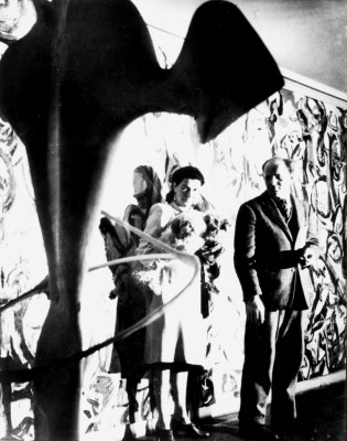 Peggy Guggenheim and Jackson Pollock with the mural in the entrance hall of her town house, ca. 1945Photograph by George Carger