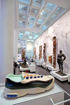 """Connecting Cultures"" installation, with Ghanaian artist Paa Joe's Coffin in the Form of a Sneaker, foreground, and Gaston Lachaise's Standing Woman, right, with New Guinea ancestral figures behind them. Photograph by Marilynn K. Yee."